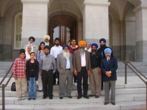 After the hearing, California Sikhs pose together on the steps of the State Legislature in Sacramento.
